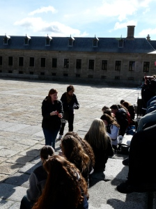 I walk our entire exchange group through the multi-step process of setting up their Spanish cell phones outside El Escorial.